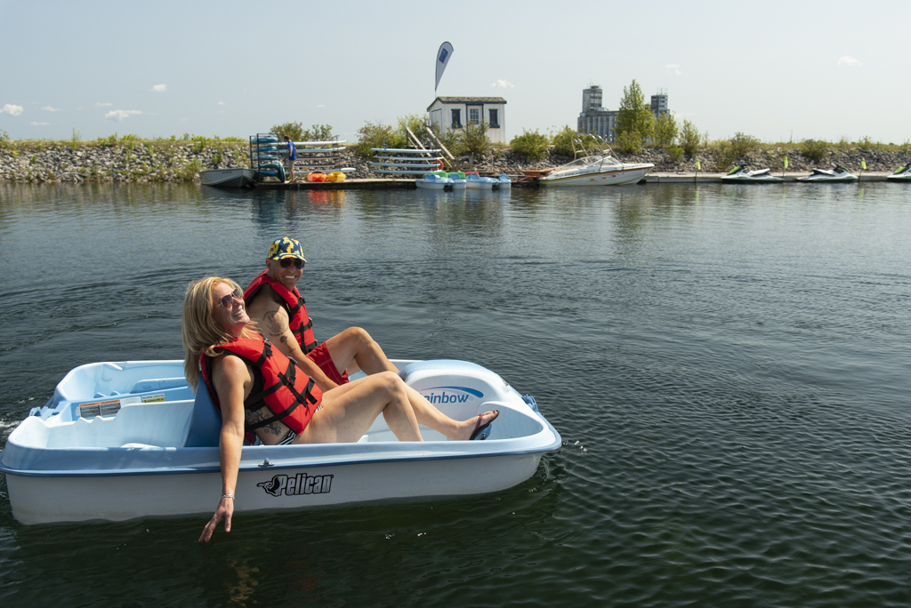 Image of a couple pedal boating