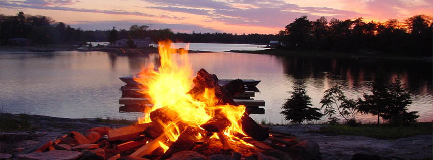 Image of bon fire on a waterfront beach