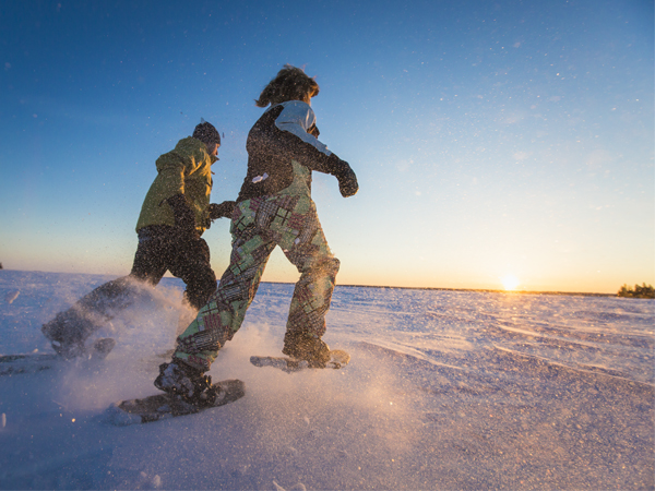 Image of a couple snowshoeing